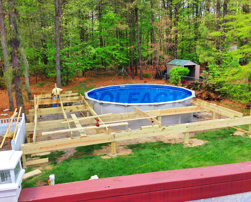 Pool deck ideas partial deck the pool factory for Above ground pool with decks