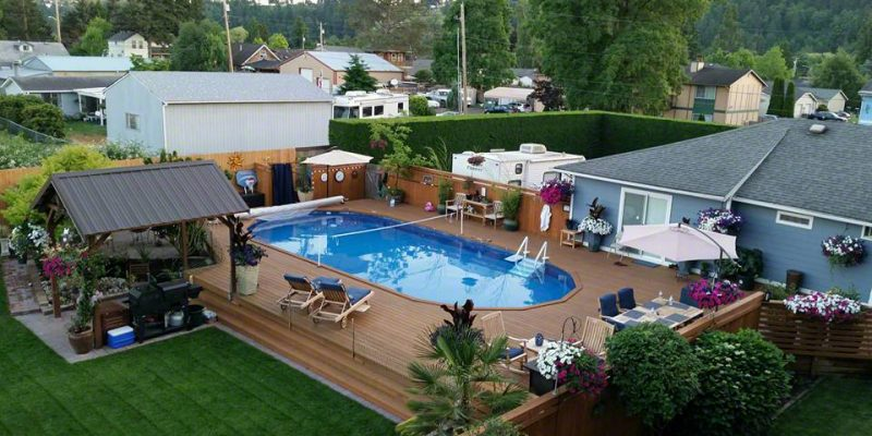 Above ground pool with deck near me with the deck going for Inground pool dealers near me