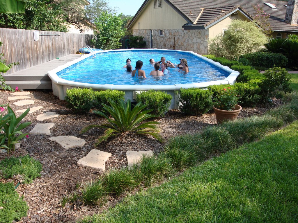 Cheap pool landscaping ideas Above Ground Decorative Shrubbery Around Pool The Pool Factory Landscaping Around Your Above Ground Pool